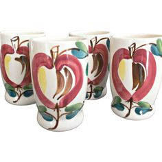 Four Purinton Pottery, 1936-1959, vintage tumblers in the Apple Pattern.  Each tumbler measures five inches tall and shows an apple with green leaves