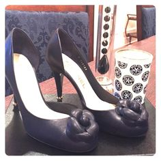 Chanel pumps Stunning Chanel heels in navy with their classic flower design.  Has a gold ring around the heel which makes it sexy and unusual.  Never been worn.  The mark on the sole is where I took off the price sticker.  If you need more pictures please ask.  True to size. Brand new and authentic.   Buy with confidence.  The style name is Chaus Ouvertes.  Comes with original package dustbag, card and box. With original tags on the box CHANEL Shoes Heels