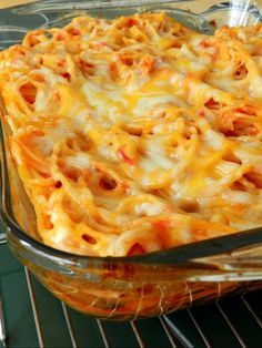 Baked spaghetti! We like this better than regular spaghetti! Such an easy recipe too. I added onion and ground beef. Delicious!