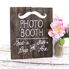Help your guests find the photo booth with this fun sign.