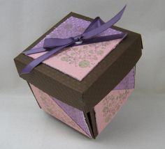 If you're buying a gift to give for a family member or a friend, a handmade gift box is a great way to add just a touch of personalization to that gift. To make your own gift box, don't miss this free #tutorial from PurpleCows.