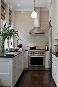 Take It to the Top - The 19 Most Incredible Small Spaces on Pinterest - Southernliving. Clean white tile, installed up to the trim, adds visual interest and texture without cramping the narrow kitchen.   See Pin