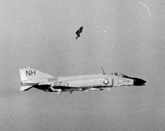 April 24, 1967-Lieutenant Commander Charles E. Southwick and Ensign James W. Laing, flying an F-4 Phantom II of Fighter Squadron (VF) 114 off the carrier Kitty Hawk (CVA 63), engaged North Vietnamese MiG-17 fighters over the enemy air base at Kep. They shot down one enemy jet, but their plane suffered battle damage that forced them to eject over the Tonkin Gulf. In this photograph, Ensign Laing has just punched out, soon to be followed by Southwick.