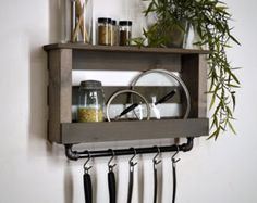[ D E S C R I P T I O N ] Add a touch of country style to your kitchen. This pot and lid rack mounts to the wall freeing up cabinet space. A 24 cast iron bar is firmly attached to the bottom with 6 hooks to conveniently hang pots, pans, and utensils you use most. -------------------------------------------------- [ F I N I S H / C O L O R ] Light Walnut  -------------------------------------------------- [ D I M E N S I O N S ] 29 Width x 10 Height x 6 Depth Overall height including bar is…