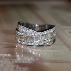 Round and Baguette Cut Diamond Wedding Band (18k White Gold). $2500.00 via Etsy.
