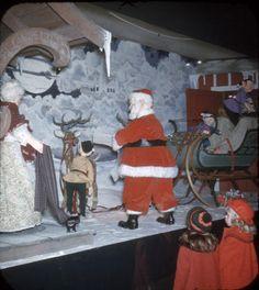 Famous-Barr Christmas window. Dec. 1951.Santa prepares for his Christmas flight. ©Missouri History Museum