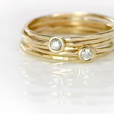 Diamond Stack Rings Set - 14k Yellow Gold Stackable Rings, White Diamonds and Solid 14k Yellow Gold Bands, Five Rings, Hammered Gold Bands. $518.00, via Etsy.