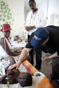 Project HOPE Responds to Cholera Outbreak in Haiti. Jason Harris, a pediatric infectious disease specialist volunteering with Project HOPE, examines a young cholera patient at the Hospital Albert Schweitzer on Saturday, October 30, 2010 in Deschapelles, Haiti.
