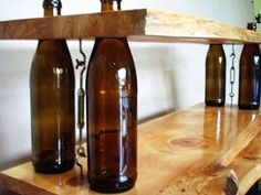 """Gorgeous upcycling of old bottles t make a cool shelf. Notice the tensioners used to pull together the shelving. I think you could """"half"""" drill the boards for the bottles to feed in as posts and if necessary cut the bottles so the cable is inside."""