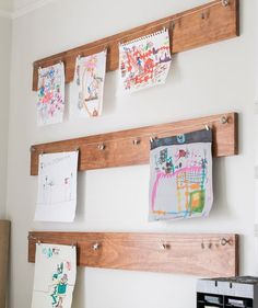 For a rustic look, take some stained wood boards and hang them horizontally on the walls. On each board, place eyelet screws on the ends and string wire from them. Attach clips to the wire to hang photos and other mementos.