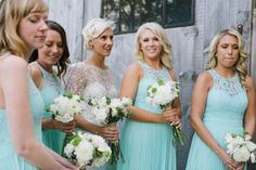 The bride and bridesmaids were beautiful in lace at this South Pond Farms wedding! Danielle French arranged bouquets with white flowers and touches of green that looked great with the soft blue bridesmaid's dresses!