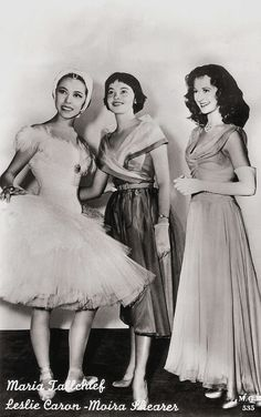 https://flic.kr/p/F6XHL9 | Leslie Caron, Moira Shearer and Maria Tallchief | Vintage card no. 535. Photo: Metro-Goldwyn-Mayer.   French film actress and dancer Leslie Caron (1931) was one of the most famous Hollywood stars in the 1950s. She is best known for the waif-like gamines in musical films like An American in Paris (1951), Lili (1953), and Gigi (1958) . Since the 1960s she's also working in the European cinema.  Red headed Moira Shearer (1926–2006) was a luminous star of the British…