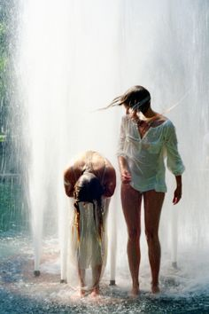 freedom is.... playing in a water fountain in the heat of summer