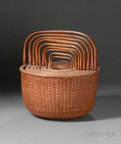 Nesting Set of Ten Nantucket Baskets, made by Jose Formoso Reyes, Nantucket, Massachusetts, third quarter 20th century, deep round form, each basket with carved white oak bale handleand turned wooden bases signed by the maker on the bottom with an outline of the island on all but the smallest basket, ht. to top of upright handle ranging from 4-14 1/2, dia. 3-13 1/2 in.          The smallest basket with losses on the rim lashing, (1 in. and 2 in. areas of loss), the largest  Sold $ 30,810