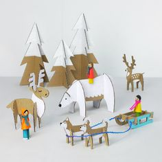 19 Adorable Animal-Inspired Holiday Decor Picks - Peg Dolls Winter Wonderland: See how to make this cute arctic scene with DIY printables. It makes a fun project for the kids on a cold winter evening- via Mr. Printables