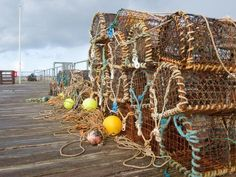 size: Photographic Print: A Selection of Lobster Pots on the Boardwalk in Aberdovey, Wales UK by DJTaylor : Pot Image, Seaside Garden, Wales Uk, Cymru, Framed Artwork, Find Art, The Selection, Royalty Free Stock Photos, Fair Grounds