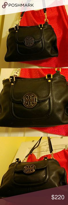 Tory Burch bag Black tory Burch bag. Has short carry handles and a shoulder strap. Has a small mark on front shown in 4th pic. Other than that..flawless.  Great size for everyday use.front pocket back pocket. 2 large zip pockets snap close inside with 2 small pockets n zip pockets inside. Goldtone hardware. Very roomy. Dust bag included Tory Burch Bags Satchels