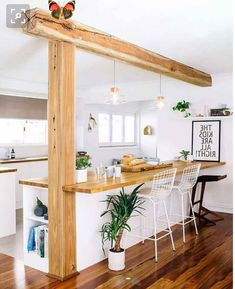 Would likely need to maintain a pillar at the end of a kitchen island for the flat - this would be the dream but it would probably be something less rustic in reality!<br> Farmhouse Kitchen Island, Kitchen Island Decor, Home Decor Kitchen, Kitchen Islands, Kitchen Bars, Kitchen Ideas, Kitchen Floors, Kitchen Tables, Country Kitchen