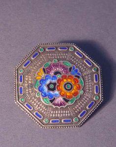 Silver brooch w/ enamelling
