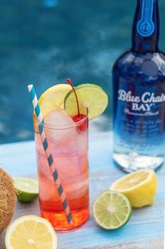 Coconut Madness is a delicious tropical rum cocktail recipe. This simple, fruity drink is easy to make and requires only a few ingredients. It uses juice, syrup, soda, and fresh ingredients as a garnish. Click here for the full recipe! #BCBHappyHour #coconutrum #bluechairbayrum