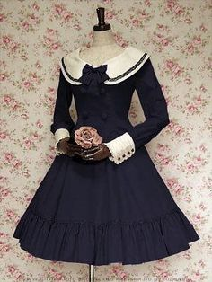 Although this definitely has some historical aspects (note the sleeve and collar), it is so 'sailor' cute, that I can imagine it with one of those sailor-type berets...so cute!