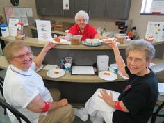 PIZZA PARTY! Donors Pat Dieringer (left), 57 LTD and Maryann Bremke (50 LTD Today!) enjoy a free pizza lunch from Pizza Factory, served up by CBC Donor Cafe volunteer Joann Snowden at the downtown Dayton CBC. Free pizza today at the Dayton CBC for everyone who registers to donate!