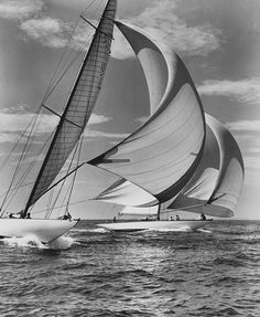 Zio and Nightwind are reaching, under spinnakers, down the middle of Long Island Sound during the New York Yacht Club Cruise of 1939.