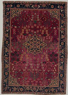 Medallion rug with a field of flowers, 17th century; Safavid, probably Kirman, Iran.