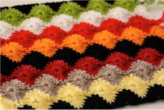 The harlequin stitch is a great technique for a project where you want to show off your crochet skills (like a baby shower or wedding gift, perhaps). While this stitch looks complicated, there are several variations that are a little easier.