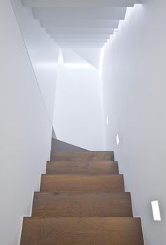Notting Hill Remodel: The light from above emphasizes the sculptural quality of the stairs.
