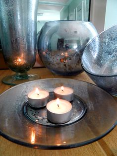 DIY Mercury Glass...a little washi tape to spruce up those bare tealights (or use votives) and this is a pretty neat display.