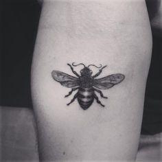 Honey bee tattoo by Sam King at Golden Spiral tattoo, Greensboro NC, USA