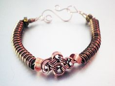 Copper Coil Wire Bracelet. $15.00, via frostBite Designs on Etsy.