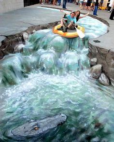 3D pavement art is german artist Edgar Müller. This is a painting. It was painted on the road.