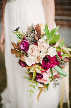 winter wedding bouquet - photo by Britt Taylor Photography http://ruffledblog.com/rich-toned-wedding-ideas-in-northern-california #weddingbouquet #flowers #bouquets