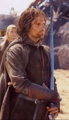 Aragorn <---- lol only doing it cause of Legolas in the background Aragorn Lotr, Legolas, Fellowship Of The Ring, Lord Of The Rings, J. R. R. Tolkien, Viggo Mortensen, Jackson, Great Love Stories, The Hobbit