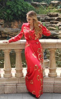 Fabulous boho silk gown featuring long sleeved design in latest fashion. This handmade red dress features an elegant button up front. Shop our online boutique!
