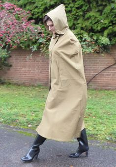 A lovely waterproof cape for ladies, which is crafted in single texture rubber lined iridescent cotton bright yarn, in a distinguished shade of old gold. Capes, Red Raincoat, Rain Cape, Rubber Raincoats, Raincoats For Women, Rain Wear, Lady, Rain Boots, Going Out