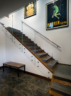 Grand stair with precast concrete threads Tagged: Glass Railing, Concrete Tread, Living Room, Ceramic Tile Floor, and Bench. Photo 1 of 43 in Taphouse by GriD
