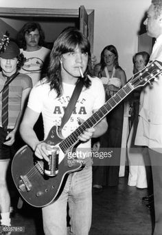 Photo of AC/DC and Malcolm YOUNG and Angus YOUNG; Malcolm Young and Angus Young (behind) backstage ... So young...so damn cute.