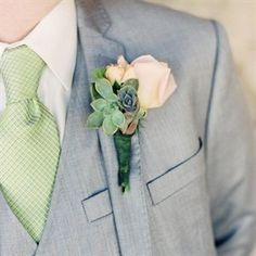 Blush rose with succulents for the groom and groomsman boutennieres