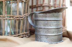 tin pitcher