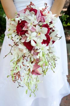 this beautiful and fresh bouquet includes touches of a deep red and white, which creates a contrast of freshness with a little drama!