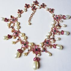 This outstanding full Gripoix clustered flower oversized teardrop pearl necklace is from Chanel 1995 Spring with stamp on the back, that reads CHANEL 95P MADE IN FRANCE.  The arrangement of its bright pink colored glass flowers and fully handmade Gripoix luscious pearls are so rich and so complete to satisfy a fullness of a beautify art piece.