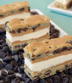 Chocolate chip cookie ice cream sandwiches with peanut butter make a great dessert for kids and adults! Make them ahead of time and keep in the freezer.