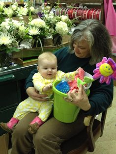 One of our designers, Tami, with little Harper! She loved her Easter basket... and her boots!