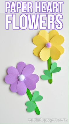 These paper heart flowers made from construction paper, popsicle sticks and pom poms are SO CUTE. And they're really easy to make! You can make these flowers using simple craft supplies - and they loo Easy Mother's Day Crafts, Mothers Day Crafts For Kids, Spring Crafts For Kids, Paper Crafts For Kids, Simple Crafts, Cardboard Crafts, Kid Crafts, Paper Flowers For Kids, Paper Flower Wreaths