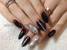Gel nails, pointed nails, almond nails, stiletto nails, glitter nail art, silver glitter, studs.