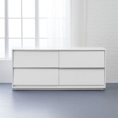 Shop shake low dresser.   White space angles a modern slant on Shaker style by MASHstudios.  The absence of ornamentation originates from an honest design approach: deconstructing and stripping away unnecessary detail until just the essence remains.