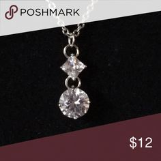 Necklace Beautiful CZ pendant on a silver tone chain. Stone has brilliant color to it. A showstopper! Jewelry Necklaces